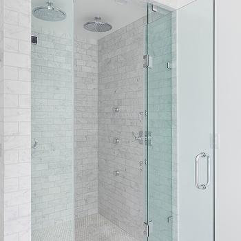 Corcoran - bathrooms - seamless glass shower, glass shower door, his and her shower heads, dual shower heads, two shower heads, rainfall shower head, marble subway tile, marble tiled shower surround, marble mini hex floor tile, marble mini hex tile, body jets, shower body jets, marble subway tiled shower, shower with 2 shower heads,
