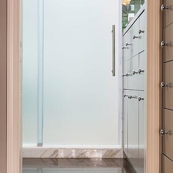 Virtus Design - bathrooms - frosted shower door, sliding shower door, sliding frosted glass shower door, glossy bathroom tile, glossy bathroom floor tile, glossy brown floor tile, gray built in dresser, modern gray dresser, round nickel drawer pulls, vanity mirror, polished nickel bathroom sconce, frosted glass sliding shower door, dresser sink vanity, double sided shower, shower with 2 doors, pedestal sink, skylight, bathroom skylight, skylight in bathroom, 2 door shower,