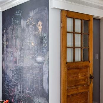 Kristina Crestin Design - boy's rooms - kids playroom, chalkboard wall, kids chalkboard wall, playroom chalkboard, playroom chalkboard walls, rustic wood toy carts, rustic toy carts, vintage toy carts, sliding doors, sliding interior doors,
