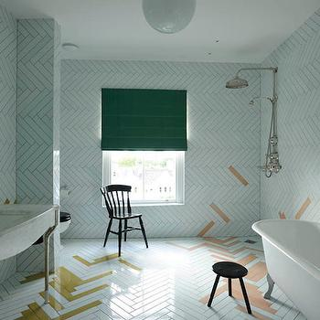 Studio Too Good - bathrooms - herringbone tiles, white herringbone tiles, herringbone backsplash, white herringbone backsplash, bathroom herringbone tiles, green roman shade, salt chair, black slat chair, open shower, open shower ideas, exposed plumbing, shower with exposed plumbing, convex mirror, wood convex mirror, brown convex mirror, vintage glass shelf, marble washstand, marble top washstand, marble sink vanity, 2 leg vanity, gold herringbone tiles, claw foot tub, multi panel mirror, over the tub mirror,