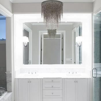PLD Custom Homes - bathrooms - gray crystal chandelier, bathroom chandeliers, sleek bathrooms, white bathrooms, vanity nook, vanity alcove, washstand nook, washstand alcove, bathroom nook, bathroom alcove, his and her sinks, white marble countertop, inset vanity mirror, white marble tiles, white marble floor, white and gray bathrooms, bathtub alcove, tub alcove, gray marble, gray marble tiles, drop in tub, marble clad bathtub, walk in shower, marble tub surround, gray marble tub surround, gray chandelier,