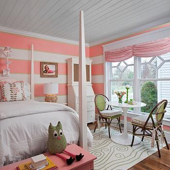Cottage Company Interiors - girl's rooms - coral pink room, coral pink kids room, coral pink kids bedroom, coral pink bedrooms, planked ceiling, kids room plank ceiling, plank ceiling in kids room, 4 poster bed, white 4 poster bed, kids 4 poster beds, pink and green pillows, pink and green floral pillows, pink trunk, pink kids trunk, kids trunks, toy trunks, pink toy trunk, kids desk, kids secretary desk, driftwood lamp, round driftwood lamp, striped walls, striped kids room walls, striped kids bedroom, striped kids room, white and pink striped walls, coral pink striped walls, saarinen table, wicker chairs, pink shades, pink window treatments, pink ruched shades, ruched shades, ruched roman shades,