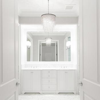 PLD Custom Homes - bathrooms - bathroom doors, master bathroom doors, double bathroom doors, double doors bathroom, crystal chandelier, bathroom chandeliers, sleek bathrooms, white bathrooms, vanity nook, vanity alcove, washstand nook, washstand alcove, bathroom nook, bathroom alcove, his and her sinks, white marble countertop, inset vanity mirror, white marble tiles, white marble floor, white and gray bathrooms,