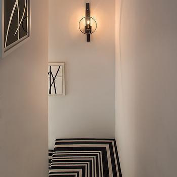 Michael Dawkins Home - entrances/foyers - black and white abstract art, black and white stairs, black and white stairway, black and white staircase, black and white staircase runner, black and white staircase runner, striped stairway runner, striped stair runner, black and white striped stairway carpet, round iron wall sconce, forged iron wall sconce, staircase lighting, staircase wall sconce, stairway wall sconce, black and white stair runner, striped stair runner, black and white stair runner, black and white striped stair runner, staircase sconces,