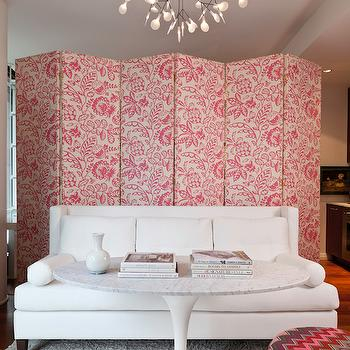 Hyde Evans Design - living rooms: pink floral floor screen, pink botanical room divider, upholstered room divider, upholstered floor screen, folding floor screen, white sofa, contemporary white sofa, white sofa with bolster cushions, saarinen coffee table, marble saarinen table, white shag rug, shag rug, pink chevron pouf, chevron pouf, room divider ideas, floor screen ideas, branch chandelier, modern branch chandelier, modern petal chandelier, folding screen, folding screen room divider, pink floral folding screen, round pink pouf,