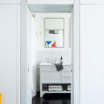 Lonny Magazine - bathrooms - closets flanking door, closets flanking doorway, bi fold closet doors, built in closets, built in wardrobe, built in wardrobe cabinets, master bedroom wardrobe, master bedroom closets, freestanding washstand, marble subway tiles, glossy black floors,
