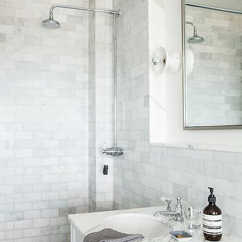 Lonny Magazine - bathrooms - shower ideas, walk in shower ideas, marble shower tiles, marble subway shower tiles, rain shower head, exposed shower plumbing, herringbone shower floor, marble herringbone tiles, marble herringbone shower floor, marble subway backsplash, nickel mirror, nickel vanity mirror, white washstand, marble countertop,