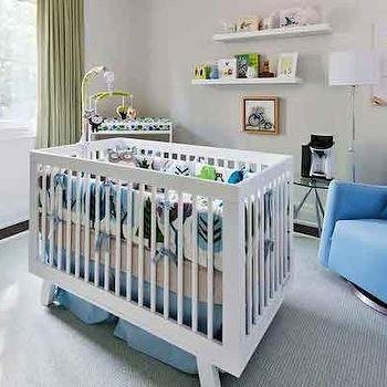House & Home - nurseries - Benjamin Moore - Cloud Cover - contemporary nursery, contemporary boys nursery, blue and green nursery, green curtains, off white wall paint, off white paint colors, crib center of the room, crib in center of the room, centered crib, centered nursery crib, white nursery crib, babyletto crib, hudson crib, white hudson crib, white and blue crib bedding, bound gray rug, gray rug, nursery rocker, blue rocker, blue nursery rocker, nursery shelves, stacked nursery shelves, corner changing table, catty corner changing table, corner changing table ideas, nursery furniture arrangement, nursery furniture arrangement ideas,
