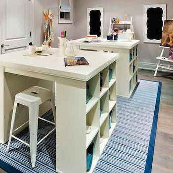 House & Home - dens/libraries/offices - craft room, craft room ideas, modular tables, modular craft tables, modular desks, craft tables, craft table ideas, pottery barn craft tables, pottery barn modular tables, white tolix stools, white tabouret stools, tabouret stools, striped rug, blue striped rug, white and blue rug, white and blue striped rug,