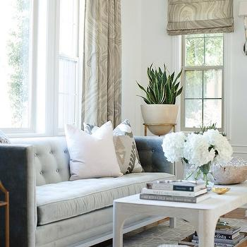Owens and Davis - living rooms: gray sofa, gray velvet sofa, gray tufted sofa, high back sofa, gray high back sofa, gray velvet tufted sofa, gray velvet high back sofa, ikat pillow, gray ikat pillows, sofa under window, sofa in front of window, beige print curtains, rectangular coffee table, brass plant stand, gray geometric rug,