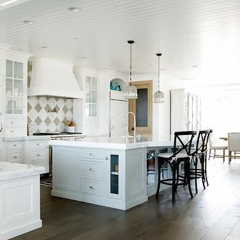 Owens and Davis - kitchens: light gray island, light gray kitchen island, light gray center island, thick marble, thick marble countertops, thick marble counters, white marble countertop, island sink, kitchen island sink, black counters tools, french cafe counter stools, black french cafe counter stools, perimeter cabinets, glass front kitchen cabinets, white kitchen hood, arched nook, arched alcove, kitchen nooks, arched kitchen nook, arched kitchen alcove, alcove over fridge, nook over fridge, over the fridge nook, over the fridge alcove, arched nook over fridge, arched alcove over fridge, beadboard ceiling, beadboard kitchen ceiling, beaded cage lanterns, cage lanterns, kitchen island lighting, kitchen island lanterns, wolf range, wide plank floors, glass front island cabinets, glass front kitchen island cabinets,