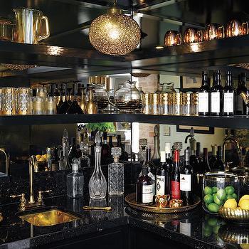 InStyle Magazine - kitchens - lauren conrad, lauren conrads home, wet bar, black wet bar, mirrored wet bar, glam wet bar, glamorous wet bar, wet bar cabinets, wet bar shelves, wet bar shelving, mirrored backsplash, mirror backsplash, black cabinets, black marble countertops, wraparound shelves, wraparound shelving, black floating shelves, wet bar sinks, gold sink, gold wet bar sink, gold faucet, gold gooseneck faucet, gold lantern, wet bar chandelier, wet bar lighting,