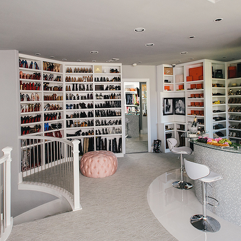 Neiman Marcus Blog - closets - two story closet, two level closet, two story wardrobe, spiral droplet pendant, spiral crystal droplet pendant, stairway lighting, staircase lighting, stairwell lighting ideas, built in shelves, built in shelving, shoe shelves, built in shoe shelves, pink tufted ottoman, pink tufted pouf, built in bar, built in curved bar, closet bar, bar in closet, wall mounted flat screen, flat screen over home bar, modern white barstools, curved front bar, shoe shelves for closet, dream closet ideas, mirrored closet door, 2 story walk in closet, closet staircase, staircase in closet, shelves for shoes, shoe shelves, glam closets, glamorous closets, shoe closet, bag closet, shoe display shelves, closet bar, walk in closet bar, pink ottoman, pink tufted ottoman,