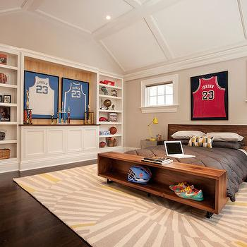 Garrison Hullinger Interior Design - boy's rooms - kids room ideas, boys rooms, boys bedrooms, boys bedroom ideas, vaulted ceiling, kids room vaulted ceiling, paneled vaulted ceiling, kids built ins, kids bookcases, kids built in bookcase, framed basketball jerseys, basketball themed kids rooms, basketball themed boys rooms, kids beds, kids platform bed, wood platform bed, kids bench, bed with built in bench, metal nightstands, yellow task lamps, gray and yellow rugs, white and gray rugs, michael jordan, michael jordan jersey, framed michael jordan jersey,