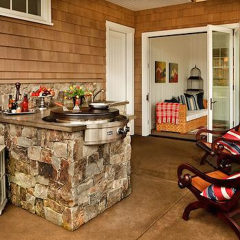 Garrison Hullinger Interior Design - decks/patios - outdoor kitchens, outdoor kitchen ideas, rustic outdoor kitchens, round cooktop, round outdoor cooktop, L shaped outdoor kitchen, stone outdoor kitchen,