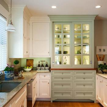 Crown Point Cabinetry - kitchens: built in hutch, built in kitchen hutch, kitchen hutch ideas, beadboard backed hutch, beadboard backed shelves, sage green hutch, green hutch, nickel cabinet pulls, round nickel hardware, natural stone counters, stone kitchen counters, single basin sink, stainless steel undermount sink, white glass pendant, integrated kitchen hutch, lighted kitchen hutch, inset cabinets, stainless steel dishwasher, U shaped kitchen, cottage kitchen, farmhouse style kitchen, ceiling height cabinets, recessed lighting, kitchen hutch, hutch with beadboard trim, kitchen hutch with beadboard trim, sage green kitchen hutch, lit hutch, lit kitchen hutch, farmhouse kitchens, country kitchen,
