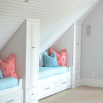 Jenkins Interiors - girl's rooms - attic kids room, shared kids room, attic kids bedroom, sleepover rooms, attic sleepover rooms, planked ceiling, built in beds, built in bed with drawers, built in storage beds, kids bedding, pink and blue bedding, built in cabinets,