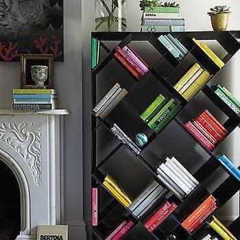 Storage Furniture - Tip-Turned Bookshelf I anthropologie.com - sloped bookcase, angled bookcase, metal slanted bookcase, metal slanted bookshelf,