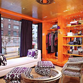 closets: tory burch, tory burch closet, glam walk in closet, glamorous walk in closet, purple and orange closet, orange lacquered built ins, mirror backed closet, mirror lined closet, decorative closet shelves, built in closet shelves, mirror backed closet shelves, floor to ceiling closet built ins, barrel back french chair, silver barrel back chair, purple ikat floor pillow, purple suzani pillow, plum velvet drapes, purple velvet drapes, purple drapes with orange trim, velvet drapes with grosgrain trim, white leather chaise, white leather daybed, gold leafed ceiling, gold ceiling, metallic gold ceiling, braided sisal rug, glossy orange built ins, black and white barrel back chair, closet seating, walk in closet seating, lacquered orange closet, glam closets, glamorous closets, purple and orange rooms, purple and orange closets, mirrored backs of shelves, mirror on backs of shelves, mirrored back shelving, mirrored back built ins, orange built ins, orange built in cabinets, orange shelves, orange lacquered closets, orange lacquered cabinets, silver chairs, silver french chairs, white and purple chairs, purple chairs, ikat floor pillows, plum curtains, plum drapes, purple velvet curtains, purple and orange curtains, closet chaise, chaise in closet,