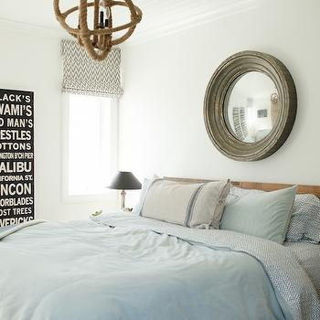 Owens and Davis - bedrooms - convex mirror, mirror over bed, reclaimed wood headboard, blue gray bedding, blue gray duvet, vintage grain sack pillows, vintage subway signs, chevron roman shade, gray chevron roman shade, dip dyed stools, rope chandelier,