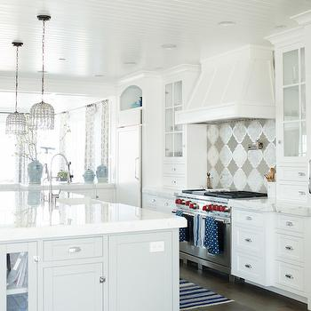 Owens and Davis - kitchens: light gray island, light gray kitchen island, light gray center island, thick marble, thick marble countertops, thick marble counters, white marble countertop, island sink, kitchen island sink, perimeter cabinets, glass front kitchen cabinets, white kitchen hood, arched nook, arched alcove, kitchen nooks, arched kitchen nook, arched kitchen alcove, alcove over fridge, nook over fridge, over the fridge nook, over the fridge alcove, arched nook over fridge, arched alcove over fridge, beadboard ceiling, beadboard kitchen ceiling, beaded cage lanterns, cage lanterns, kitchen island lighting, kitchen island lanterns, quatrefoil tiles, silver and gray tiles, quatrefoil kitchen tiles, quatrefoil backsplash, cooktop backsplash ideas, quatrefoil backsplash tiles,