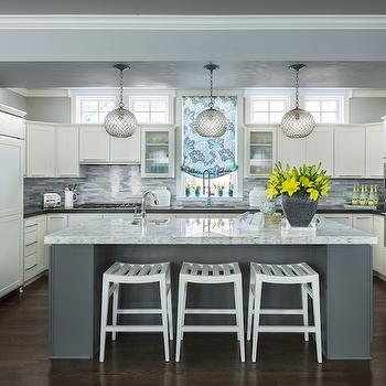 Martha O'Hara Interiors - kitchens - combination microwave wall oven, stainless steel wall oven, single wall oven, integrated microwave, microwave over oven, dark hardwood floors, gray kitchen island, white marble counter, marble topped kitchen island, contemporary white counter stool, backless white counter stool, prep sink, corner prep sink, kitchen island prep sink, modern spray faucet, gooseneck faucet, white shaker cabinets, shaker front cabinets, u shaped kitchen, open concept u shaped kitchen, brushed nickel cabinet pulls, white paneled refrigerator, shaker front refrigerator, paneled two door refrigerator, black counters, black quartz counters, black perimeter counters, linear white and gray glass backsplash, linear glass tile backsplash, white and gray glass tile, blue floral roman shade, glass front cabinets, glass front upper cabinets, kitchen clerestory windows, sphere shaped mini pendant, glass sphere mini pendant, kitchen island mini pendants, pinto pendants, gray walls, white and gray kitchen ideas, white counter stools, backless counter stools, pinto pendants,