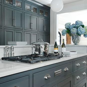 kitchens - gray cabinets, gray kitchen cabinets, grey kitchens, grey kitchen ideas, grey island, grey kitchen island, white marble countertops, white marble backsplash, gas cooktop, island cooktop, kitchen island cooktop, floor to ceiling cabinets, floor to ceiling kitchen cabinets, grey kitchens, grey kitchen ideas, white glass globe pendants,