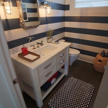 Ciuffo Cabinetry - bathrooms - horizontal striped walls, navy striped walls, white and navy walls, white and navy stripe walls, white and navy striped walls, navy stripe walls, striped bathroom walls, striped powder rooms walls, horizontal navy striped walls, rivet mirror, rivets mirror, marine sconces, nautical powder room, nautical powder room ideas, white washstand, single washstand, white single washstand, italian marble, italian marble countertop, beachy accents, beachy bathroom accents, geometric bath mat, black and white bath mat, powder room wood floors, wood floors in powder room,