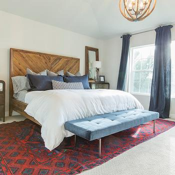 Ivory Homes - bedrooms: vintage bedrooms, red kilim rug, blue curtains, blue linen curtains, reclaimed wood bed, salvaged wood bed, west elm bed, wood herringbone headboard, herringbone headboard, wood herringbone bed, herringbone bed, gray sheet set, slate blue pillows, slate blue linen pillows, white duvet, white duvet cover, blue bench, blue velvet bench, blue tufted bench, blue velvet tufted bench, bedroom bench, industrial chests, industrial nightstands, metal nightstands, metal chests, reclaimed wood mirrors, salvaged wood mirrors, mirror on nightstand, nightstand mirror,