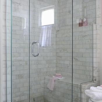 Anna Forkum - bathrooms - glass front shower, glass shower door, glass wall shower, marble subway tile, marble subway tiled shower, marble tiled shower surround, built in shower bench, tiled shower bench, built in shower seat, extra large shower, oversize walk in shower, pink towel, pink bathroom accents, pink bath towel, pebble shower tile, pebble tiled shower floor, built in shower ledge, shower ledge, recessed shower lighting, seamless glass shower, calcutta gold marble, calcutta gold subway tiles, marble shower bench, pebble shower floor, pebbled shower floor,