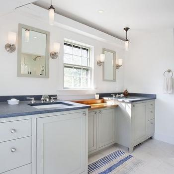 Nantucket Architecture Group - kitchens - vanity with drop down console, drop down vanity, gray shaker vanity, gray bathroom vanity, gray dual sink vanity, brushed nickel cabinet pulls, gray counters, gray countertops, nickel and frosted glass wall sconce, nickel uplight wall sconce, gray vanity mirror, gray bathroom mirror, undermount porcelain sink, his and hers sinks, butcher block counters, sash window, striped blue bath mat, striped blue bath rug, gray floor tile, gray tiled bathroom floors, blue and gray bathroom, blue and gray bathroom ideas, coastal bathroom ideas, coastal bathrooms, gray bathroom vanity, gray sink vanity, uplight sconce, uplight wall sconce, uplight bath sconce, uplight bathroom sconce,