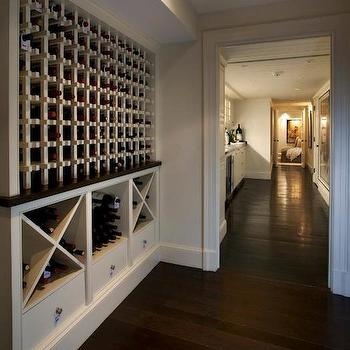 Nantucket Architecture Group - basements - built in wine rack, wine bottle storage, dark hardwood floors, wine cellar, wine room, built in wine storage, vertical wine storage, x wine rack, x wine storage, floor to ceiling wine storage, nickel hardware,