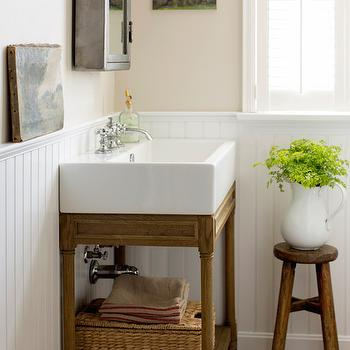 Kelly Mcguill Home - bathrooms - rustic wooden stool, farmhouse stool, white ironstone pitcher, ironstone pitcher, farmhouse bathroom, beadboard paneled half wall, beadboard clad lower wall, cafe au lait wall color, cafe au lait paint color, ceramic brick tile, ceramic brick floor tile, rattan basket, zinc medicine cabinet, mirrored zinc medicine cabinet, weathered oak console sink, weathered oak bathroom sink, single console with shelf, wooden console with trough sink, oil paintings, industrial medicine cabinet, shuttered windows, farm bathrooms, beadboard wainscoting, bathroom wainscoting, wainscoting in bathroom, bathroom brick floor, ceramic brick, ceramic brick floor, zinc medicine cabinet,