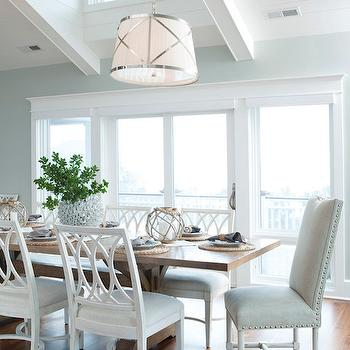 Amy Tyndall Designs - dining rooms - Restoration Hardware - Silver Sage - beach house dining room, beachy dining room ideas, coastal dining room ideas, vaulted paneled ceilings, tongue and groove ceiling, wood paneled ceilings, vaulted ceiling skylight, dining room skylight, skylight window, nickel strap drum pendant, nickel trimmed drum pendant, vaulted ceiling pendants, trestle dining table, wooden trestle dining table, white lattice back dining chair, white geometric back dining table, lattice dining chair, fisherman float candle holders, rope and glass candle holder, linen host chair, linen dining chair with nailhead trim, silver sage paint color, silver sage walls, silver sage dining room, rh silver sage, silver sage, vaulted dining room ceiling, grosvenor pendant,