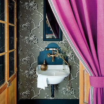 Nuevo Estilo - bathrooms: fuchsia curtains, fuchsia drapes, whimsical bathrooms, eclectic bathrooms, narrow vanity mirror, wall mounted sink, curved backsplash, sink backsplash, curved sink backsplash, gold faucet,