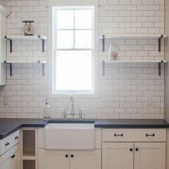 My Rafter House - kitchens - butler pantry, small butler pantry, L shaped butler pantry, butler pantry cabinets, off white cabinets, black countertops, subway tiles, ceiling height subway tiles, white subway tile with dark grout, butler pantry shelves, butler pantry shelving, iron corbels, farmhouse sink, small farmhouse sink, butler pantry sink,