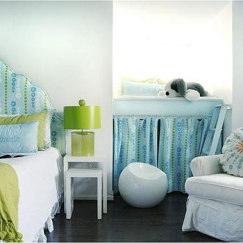 Caldwell Flake - girl's rooms - espresso hardwood floors, blue and green girls room, blue and green headboard, aqua blue and green headboard, aqua blue and green girls room, lime green tasseled throw, pom pom tasseled throw, pom pom trimmed throw, white matelasse coverlet, aqua blue lumbar pillow, blue monogrammed pillow, green glass lamp, lime green glass lamp, green lamp with green shade, white nesting side table, nightstand nightstand, small white nesting tables, modern white stool, modern plastic stool, elevated window seat, window seat with ladder, kids window seat, kids window nook, skirted window seat, kids window seat ideas, platform window seat, white slipcovered armchair, round blue and orange pillow, arched headboard, green and blue pillows, nesting beside tables, nesting nightstands, reading nook, kids reading nook, kids nook, reading nook ladder, reading nook storage, reading nook curtains,