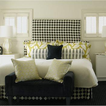 Caldwell Flake - bedrooms - checkered headboard, black and white headboard, black and white geometric headboard, harlequin check headboard, harlequin checkered headboard, black and white bed skirt, black and white checkered bed skirt, checked bed skirt, ivory matelasse coverlet, ivory coverlet, yellow hex throw pillow, geometric yellow pillow, black and white geometric lumbar pillow, geometric lumbar pillow, yellow leaf print pillow sham, yellow and white leaf sham, matching nightstand, matching bedside table, white hollywood regency nightstand, hollywood regency cabinet, white nightstand with brass hardware, white and gold table lamp, white and gold ceramic lamp, windows over nightstand, windows either side of headboard, bed in between windows, black velvet bench, bed bench, upholstered bed bench, yellow hex pillow, yellow and ivory geometric pillow, black white and yellow bedroom, black white and gold bedroom, black bench, harlequin headboard, black and white headboard, white hollywood regency cabinet, hollywood regency nightstand,