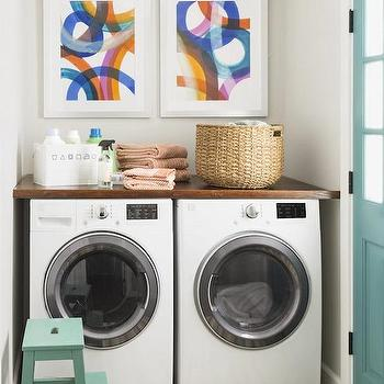 HGTV - laundry/mud rooms - turquoise doors, laundry room door, counter over washer dryer, countertop over washer dryer, counter above washer dryer, countertop above washer dryer, butcher block above washer dryer, laundry art, laundry room art, art over washer dryer, art above washer dryer, laundry step stool, laundry stool, laundry room step stool, seafoam green stool, yellow and gray rug, yellow and gray stripe rug, laundry rug, laundry room rug,