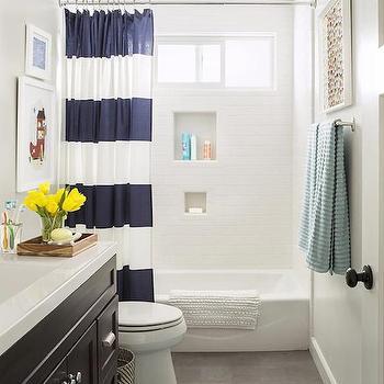 HGTV - bathrooms - kids bath, kids bathroom, stripe shower curtain, striped shower curtain, blue stripe shower curtain, blue striped shower curtain, navy stripe shower curtain, navy striped shower curtain, drop in tub, shower niche, shower subway tiles, sliding shower window, slate tiles, slate floor, slate bathroom tiles, slate bathroom floor, black sink vanity, black washstand, white quartz countertops, blue bath mat, fringed bath mat, aqua bath mat,