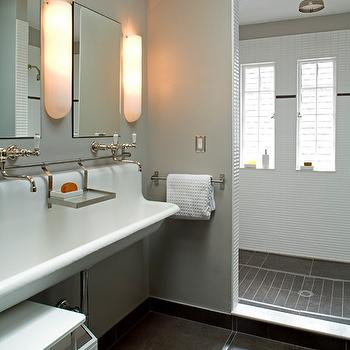 Gelotte Hommas Architecture - bathrooms - industrial bathrooms, shared bathrooms, shared kids bathrooms, shared boys bathrooms, boys bathrooms, bullet sconces, bullet shaped sconces, bullet wall lights, frameless mirrors, frameless vanity mirrors, shared sink, shared bathroom sink, shared trough sink, gray trough sink, vintage faucets, wall mounted faucets, gray tiled floor, open shower, open shower ideas, rain shower head, white stacked tiles, stacked shower tiles, gray shower floor,