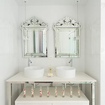Philippe Starck - bathrooms - sleek bathrooms, sleek white bathrooms, venetian mirror, venetian vanity mirror, his and her sinks, round sinks, round vessel sinks, off set faucets, repurposed vanity, polished chrome washstand, polished chrome sink vanity, 2 drawer cabinets, modern bathroom cabinet, freestanding bathroom cabinet, white glass mini pendants, mini glass light pendants,