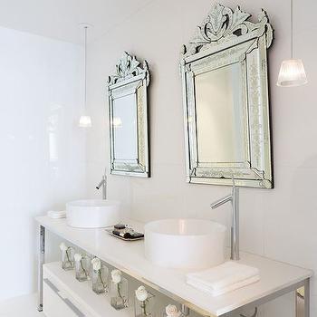 Philippe Starck - bathrooms - sleek bathrooms, sleek white bathrooms, venetian mirror, venetian vanity mirror, his and her sinks, round sinks, round vessel sinks, off set faucets, repurposed vanity, polished chrome washstand, polished chrome sink vanity, 2 drawer cabinets, modern bathroom cabinet, freestanding bathroom cabinet, white glass mini pendants, mini glass light pendants, square glass vase, white bathroom ideas, white bathroom design,