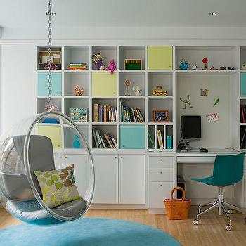Lichten Craig Architects - girl's rooms - round blue rug, round turquoise rug, hanging acrylic chair, hanging kids chair, bubble chair, acrylic bubble chair, floor to ceiling built ins, kids room built ins, built in kids desk, built in cubby shelving, cubby shelves, cubbies with doors, cubby shelves with doors, glass topped built in desk, turquoise swivel desk chair, girls room built ins, kids rugs, kids lounge chairs, kids hanging chairs, kids hanging acrylic chair, kids hanging bubble chair, kids acrylic bubble chair, kids built ins, kids built in cabinets,