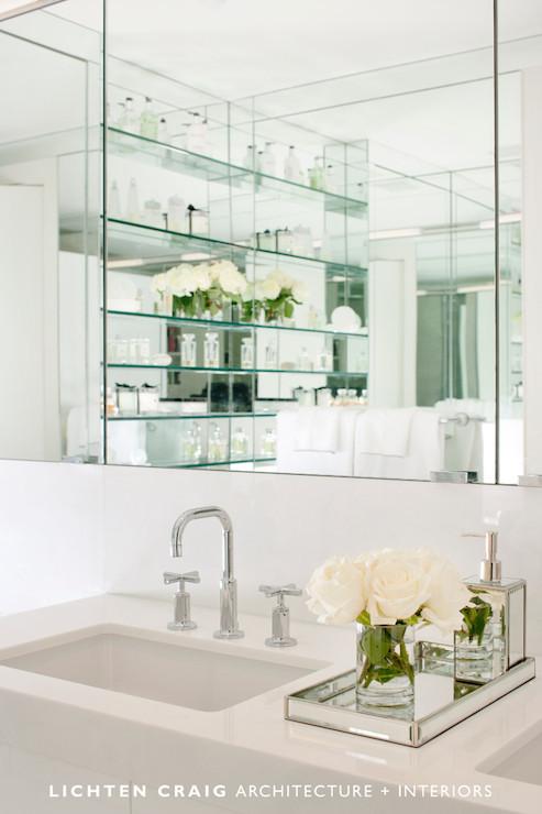 Lichten Craig Architects - bathrooms - mirrored tray, mirrored vanity tray, mirrored bathroom accessories, mirrored soap dispenser, modern faucet, undermount porcelain sink, white counters, white bathroom vanity, white bathroom countertops, paneled vanity mirror, vanity vignette, bathroom counter vignettes, mirror backed shelves, glass bathroom shelves, mirror paneled shelves, glass shelves, white bathroom ideas, mirrored tray, mirrored bathroom tray,