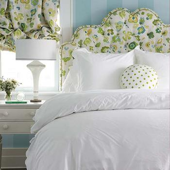 Seldom Scene Interiors - bedrooms - green and blue floral headboard, floral headboard, floral upholstered headboard, scalloped white bedding, scalloped white bed linens, scalloped white duvet, round green polka dot pillow, green polka dot pillow, white two drawer nightstand, white bedside table, tapered white table lamp, white porcelain table lamp, floral roman shade, ruched roman shade, green and blue floral shade, blue tonal striped walls, vertical striped walls, blue on blue striped walls, painted striped walls, blue striped walls, tonal striped walls, floral headboard, white scalloped bedding, scalloped bedding, scalloped duvet, white scalloped duvet, round polka dot pillow, striped walls, blue striped walls, striped bedroom walls, vertical striped walls,