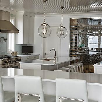 Lillian August - kitchens - beadboard ceiling, glossy beadboard ceiling, kitchen beadboard ceiling, 2 kitchen islands, double kitchen islands, dual kitchen islands, secondary kitchen island, kitchen island sink, sawhorse stool, white sawhorse stool, wine room, kitchen wine room, kitchen wine cellar, white kitchen cabinets, white quartz countertops, blue subway tiles, blue glass subway tiles, blue glass subway tiled backsplash, pot filler, stainless steel kitchen hood, kitchen peninsula, light gray barstools, pale gray barstools, gray leather barstools, nailhead barstools, cut out barstools, cut out back barstools,