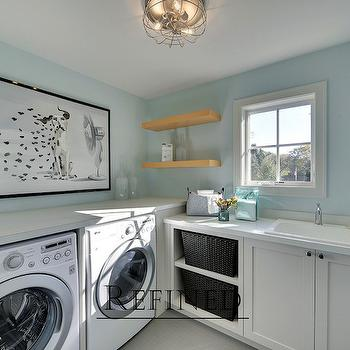 Refined LLC - laundry/mud rooms - white and blue laundry, white and blue laundry rooms, laundry rooms, blue laundry rooms, laundry art, laundry room art, dalmatian art, front load washer dryer, quartz counters, laundry sink, laundry room sink, laundry room cubbies, laundry shelves, laundry room shelves,