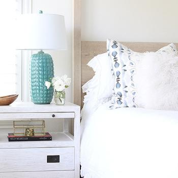 Owens and Davis - bedrooms - bedside table vignette, nightstand vignette, turquoise lamp, turquoise blue lamp, whitewashed nightstand, whitewashed bedside table, limed oak bed, white ruffle bedding,