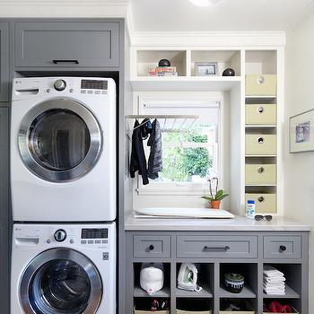 Jessica Risko Smith Interior Design - laundry/mud rooms - fold down drying rack, laundry room drying rack, fold up drying rack, laundry room storage, laundry room cubbies, laundry room cabinets, gray counters, gray laundry room cabinets, gray cabinets, oil rubbed bronze hardware, gray shaker cabinets, canvas storage baskets, oil rubbed bronze semi flush pendant, bronze pendant with white shade, stackable washer dryer, stackable front load washer, stackable laundry room appliances, ironing counter, window cubbies, built ins around window, window built ins, drying racks, drying rack ideas, laundry drying rack, laundry room drying rack, drying rack in front of window, stacked washer dryer, stacked washer and dryer, laundry folding counter,
